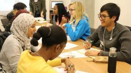 Student volunteers talking around a table