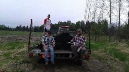 3 farmers from Just Food Farm sitting on a tractor