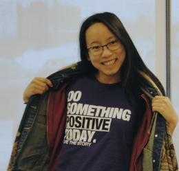 Student displaying t-shirt : Do something positive today!
