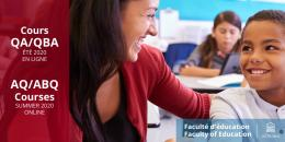 Female teacher smiling at young male student