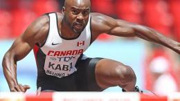 Sekou Kaba is jumping an hurdler.