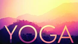 Yoga is written with moutain and a sunset.