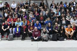 Students sitting on steps to Tabaret Hall