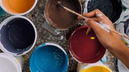 Pails of paint and a paint brush