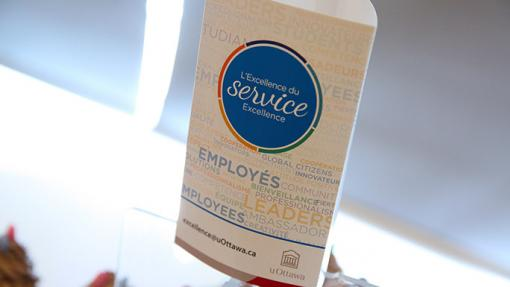 Image of a tent card with the Service Excellence logo
