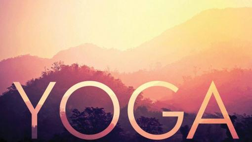 "The word ""Yoga"" is superimposed on a picture of hills at sunset."